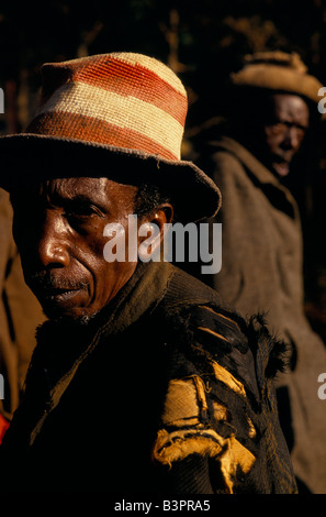 Displaced Tutsis from area around Ruyigi take refuge in a camp protected by army. Weary elderly man wearing tattered - Stock Photo