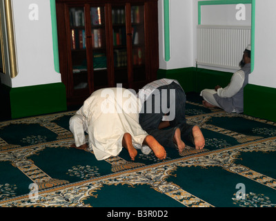 Men Praying in Shah Jahan Mosque Woking Surrey - Stock Photo