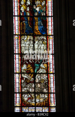 Coutances, Normandy, France. The cathedral (Notre-Dame de Coutances). Medieval stained glass window showing sinners in hell
