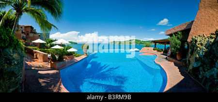 Infinity pool overlooking ocean at La Casa Que Canta resort in Mexico - Stock Photo