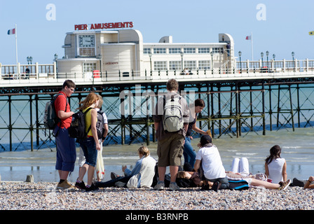 A group of youngsters on the shingle beach at Worthing West Sussex England A English seaside resort - Stock Photo