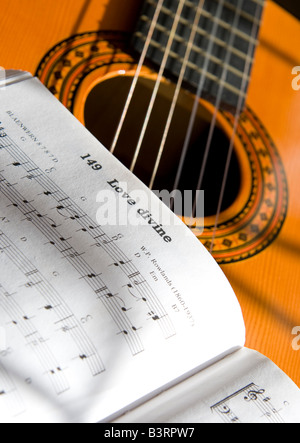 Guitar and book of music - Stock Photo