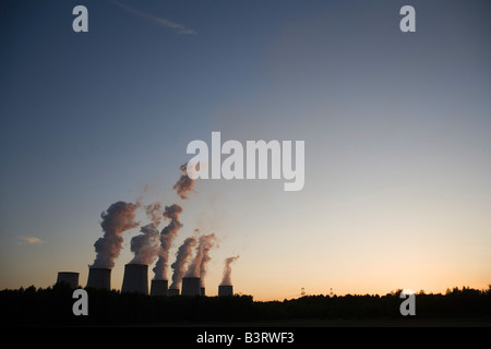 Brown coal power plant Jaenschwalde, one of the worlds power plants with the highest emission during sunset - Stock Photo