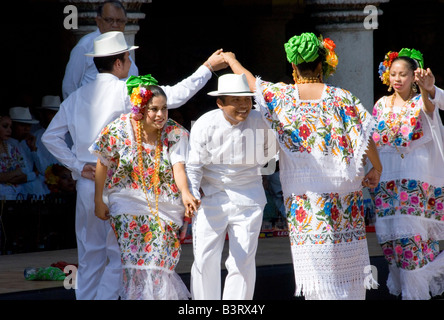 Dancers in Traditional Colourful Embroidered Dress Performing during Merida en Domingo Yucatan Peninsula Mexico - Stock Photo