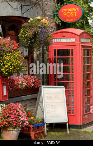 Traditional red telephone box outside Cenarth Post Office village shop Ceredigion west Wales UK - Stock Photo
