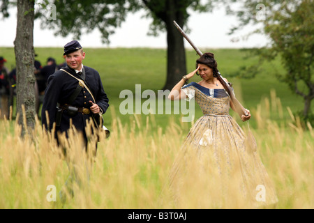 A young women flirtingly saluting a union soldier at a Civil War Encampment Reenactment - Stock Photo