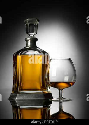 Brandy snifter decanter vertical - Stock Photo