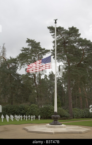 Brookwood American Military Cemetery Stars and Stripes Flies at Half Mast Before Graves of Great War Soldiers under - Stock Photo