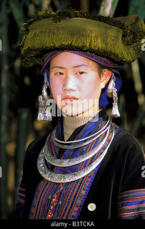 Asia, China, Xingren. Miao woman in traditional costume. - Stock Photo
