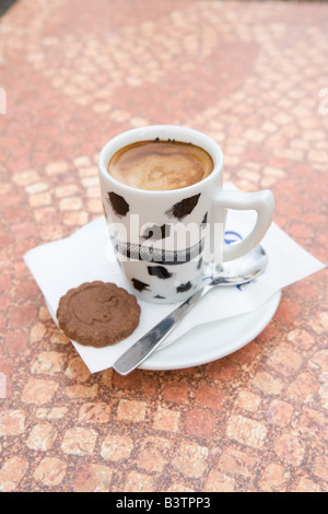 Coffe cup and biscuit at a Cafe in Hungary - Stock Photo