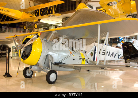 A Grumman F3F-2 bi-wing pre-WWII fighter aircraft on Static display at the Naval Air Museum, NAS Pensacola - Stock Photo