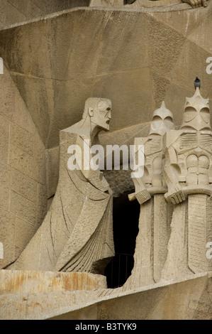 Spain, Barcelona. Gaudi's La Sagrada Familia, Passion Facade detail. Likeness of Gaudi (far left) done by Josep - Stock Photo