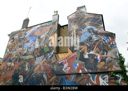 UK-mural in Cable Street,London marking the battle between Oswald Mosley's British Union of Fascists and the local - Stock Photo