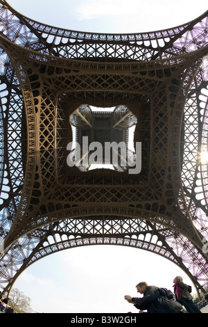 Eiffel Tower wide angle fish eye under underneath looking up view day daytime daylight Paris France Europe EU - Stock Photo