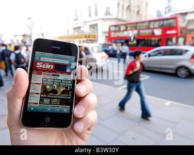 iPhone always online internet wherever you go Regent Street London UK - Stock Photo