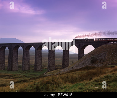 Steam train crosses Ribblehead Viaduct railway North Yorkshire dales - Stock Photo