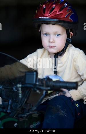 A young boy wearing a helmet - Stock Photo