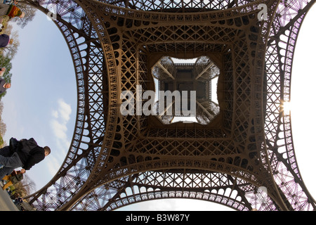 Eiffel Tower wide angle fish-eye under underneath looking up view day daytime daylight Paris France Europe EU - Stock Photo