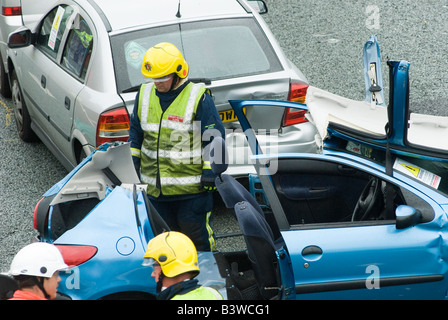 Emergency services attending a nasty road traffic accident on the m1 motorway in the midlands uk - Stock Photo