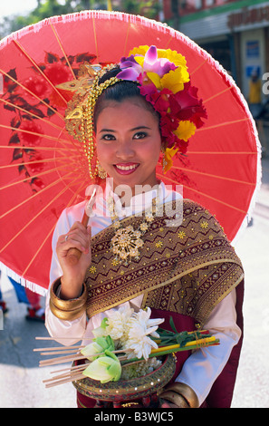 Portrait young woman in traditional Thai costume at traditional festival Chiang Mai Flower Festival Chiang Mai Chiang - Stock Photo
