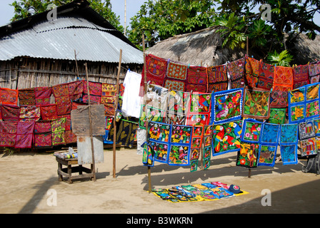 Central America, Panama, San Blas Islands (aka Kuna Yala). Colorful Kuna Indian hand stitched molas on display. - Stock Photo