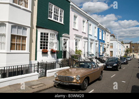 Row of expensive terraced houses in Hillgate Place, a residential street in Notting Hill, London England UK - Stock Photo