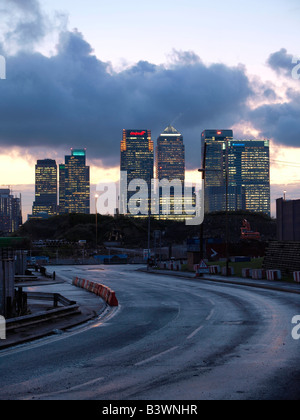 Canary Wharf bank buildings at night sunset with curvy road in front London UK - Stock Photo