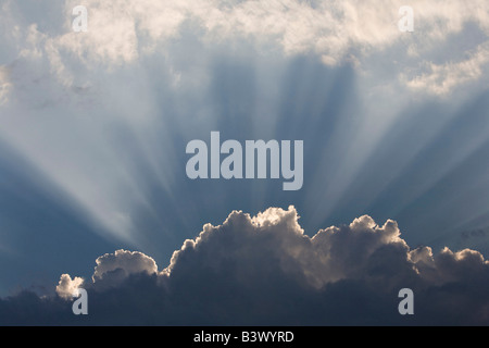 Sunlight shining up out of clouds - Stock Photo