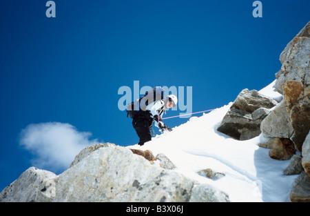 Mountain climber descending from a mountain, Elbrus region, Greater Caucasus range, Kabardino-Balkaria, Russia - Stock Photo