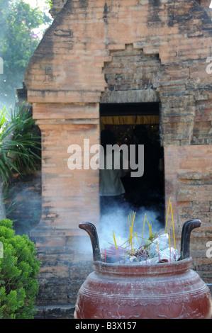 Incense burning in an urn at the Po Nagar Cham Towers Nha Trang  Vietnam - Stock Photo