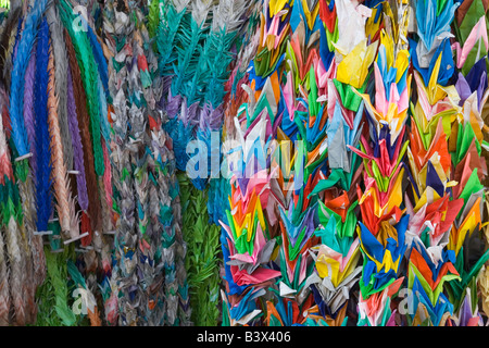 Kyoto City Japan Colorful origami cranes offered by students at Fushimi Inari Shrine Shinto 1000 cranes - Stock Photo