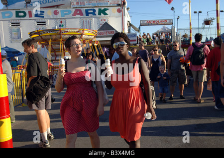 Visitors to Coney Island celebrate the end of summer on Labor Day - Stock Photo
