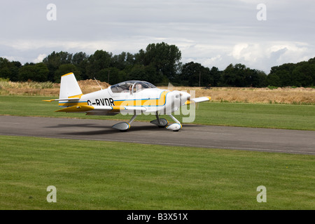 Vans RV-6A G-RVDR taxiing after landing at Breighton Airfield - Stock Photo