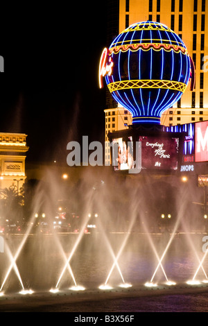 The fountains of the Bellagio Hotel and Casino dance in front of the Paris Hotel and Casino in Las Vegas Nevada - Stock Photo