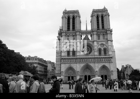 Tour Groups in front of Notre Dame Paris France - Stock Photo