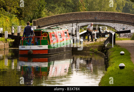 Narrow boat approaching a canal bridge at Black Jack's Lock on the Grand Union Canal Harefield Middlesex UK - Stock Photo