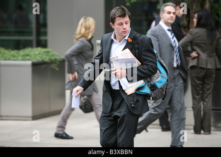 Loosing job. Evacuating desk. What else did I forget? Carrying a 'Powers of trustee in bankruptcy' document. Lehman - Stock Photo