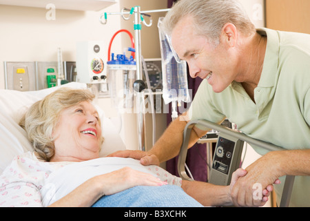 Mother And Son Laughing Together In Hospital - Stock Photo