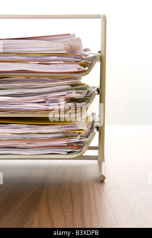A Stack Of Paperwork Sitting In A Tray - Stock Photo