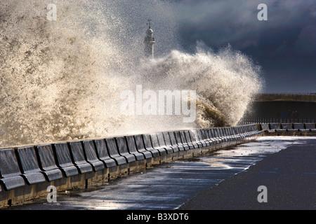 Waves crushing against barrier, Sunderland, Tyne and Wear, England - Stock Photo