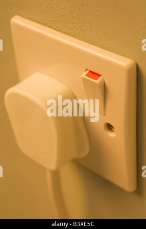 Electric Plug Connected To Outlet - Stock Photo
