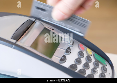 Swiping Credit Card - Stock Photo