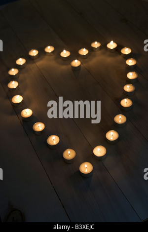 Illuminated Candles Placed In A Heart Shape - Stock Photo
