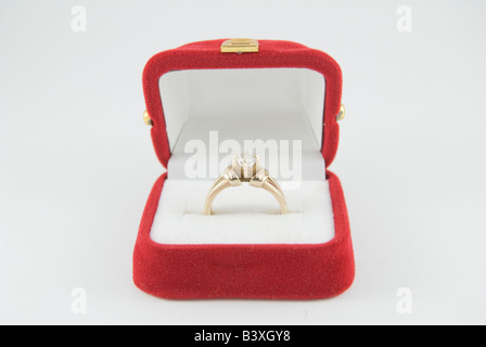 Diamond Engagement Ring in red box on white background - Stock Photo