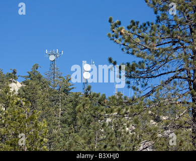 One of the many communication towers scattered across the world - Stock Photo