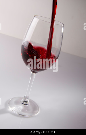 Wine pour glas white background reflection - Stock Photo