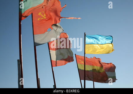 Old Soviet republics flags beside a modern Ukrainian flag waving over the pilgrim camp on the Solovetsky Islands, - Stock Photo