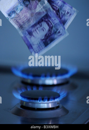 British pounds burning on a gas hob - Stock Photo