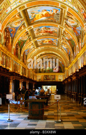 Library of Monastery of San Lorenzo de El Escorial with 16th century ceiling frescoes painted by Tibaldi near Madrid - Stock Photo