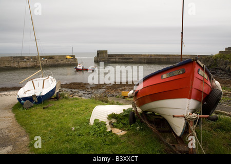 The harbour of Craster in Northumberland. The port is home to a small fishing fleet. - Stock Photo